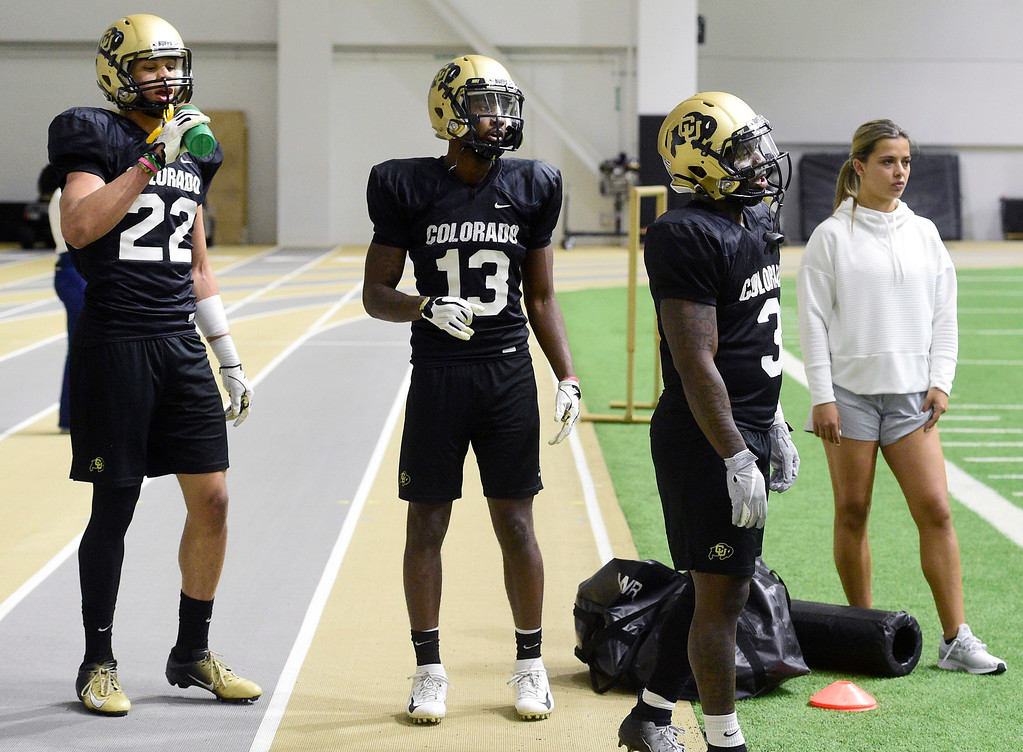 . BOULDER, CO - April 10, 2019:  Daniel Arias, left, Maurice Bell, KD Nixon, during Spring CU football practice. (Photo by Cliff Grassmick/Staff Photographer)