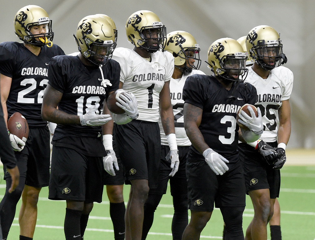 . BOULDER, CO - April 10, 2019:  Daniel Arias, left, Tony Brown, Delrick Abrams Jr, Ronnie Blackmon, KD Nixon, and Mekhi Blackmon, during Spring CU football practice. (Photo by Cliff Grassmick/Staff Photographer)