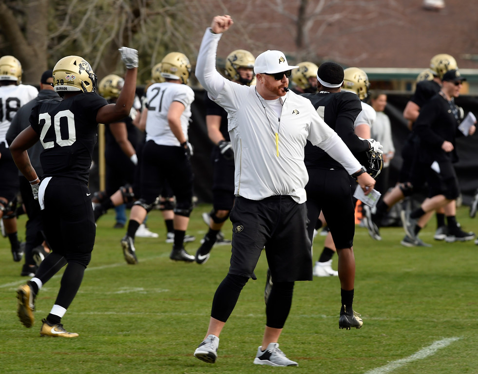 . BOULDER, CO - April 5, 2019:   Wide Receivers coach, Darrin Chiaverini, during University of Colorado Spring football practice on April 5, 2019. (Photo by Cliff Grassmick/Staff Photographer)