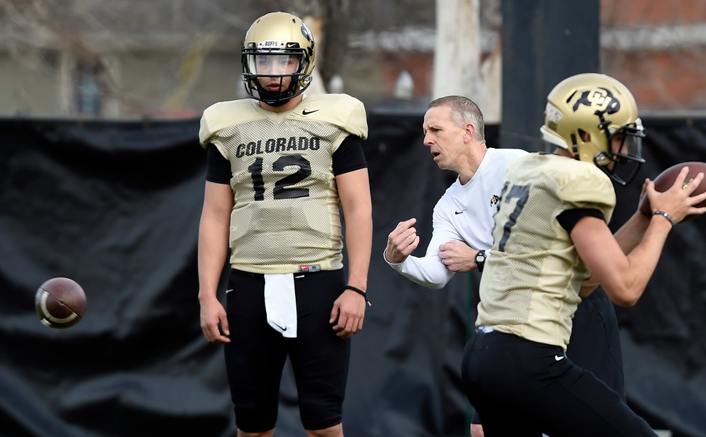 . BOULDER, CO - April 5, 2019: CU QB, Steven Montez, with OC, Jay Johnson,  during University of Colorado Spring football practice on April 5, 2019. (Photo by Cliff Grassmick/Staff Photographer)