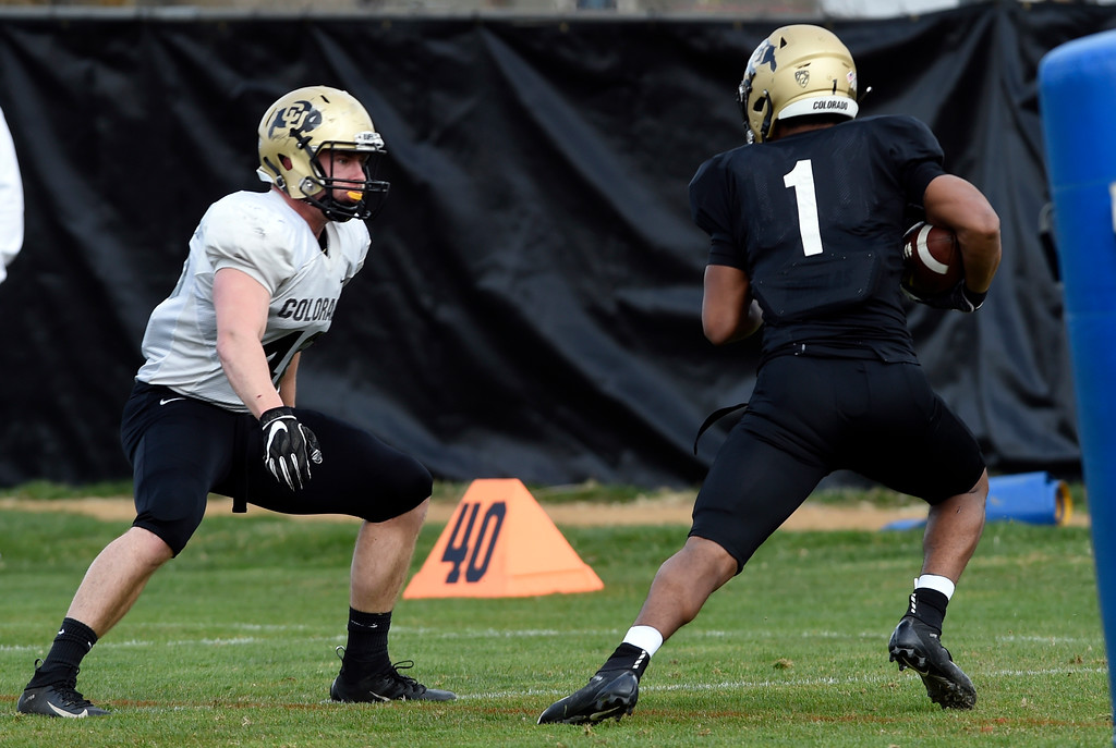 . BOULDER, CO - April 5, 2019:  Chase Newman, left, prepares to tackle Jaren Mangham during University of Colorado Spring football practice on April 5, 2019. (Photo by Cliff Grassmick/Staff Photographer)