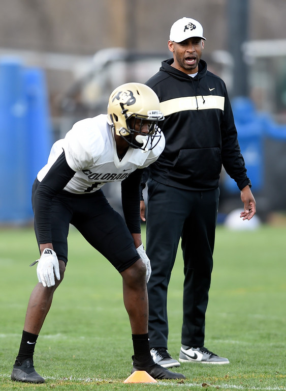 . BOULDER, CO - April 5, 2019: Defensive backs coach, Travares Tillman, right, watches Delrick Abrams, Jr.,  during University of Colorado Spring football practice on April 5, 2019. (Photo by Cliff Grassmick/Staff Photographer)