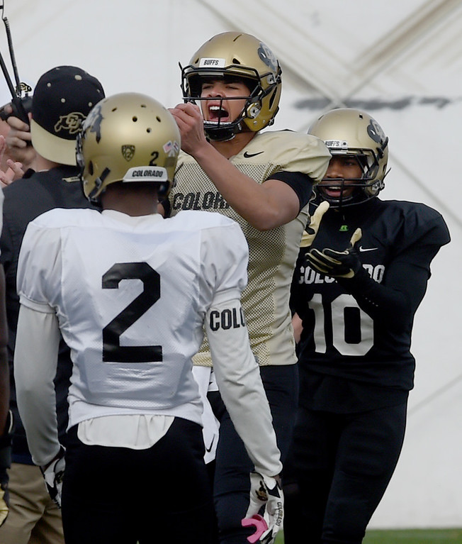 . BOULDER, CO - April 5, 2019:  CU QB, Tyler Lytle, gets excited about a teammate\'s hit in a drill during University of Colorado Spring football practice on April 5, 2019. (Photo by Cliff Grassmick/Staff Photographer)