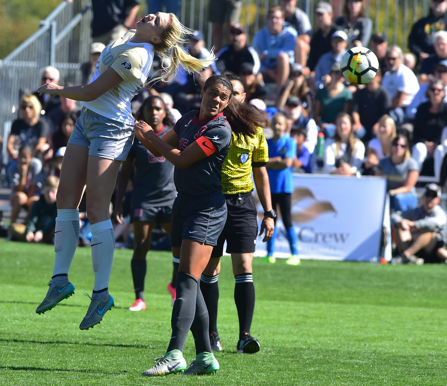 . University of Colorado\'s Taylor Kornieck flicks the ball past Stanford\'s Alana Cook during their game at Prentup Field in Boulder on Sunday.  Paul Aiken Staff Photographer Oct 8 2017