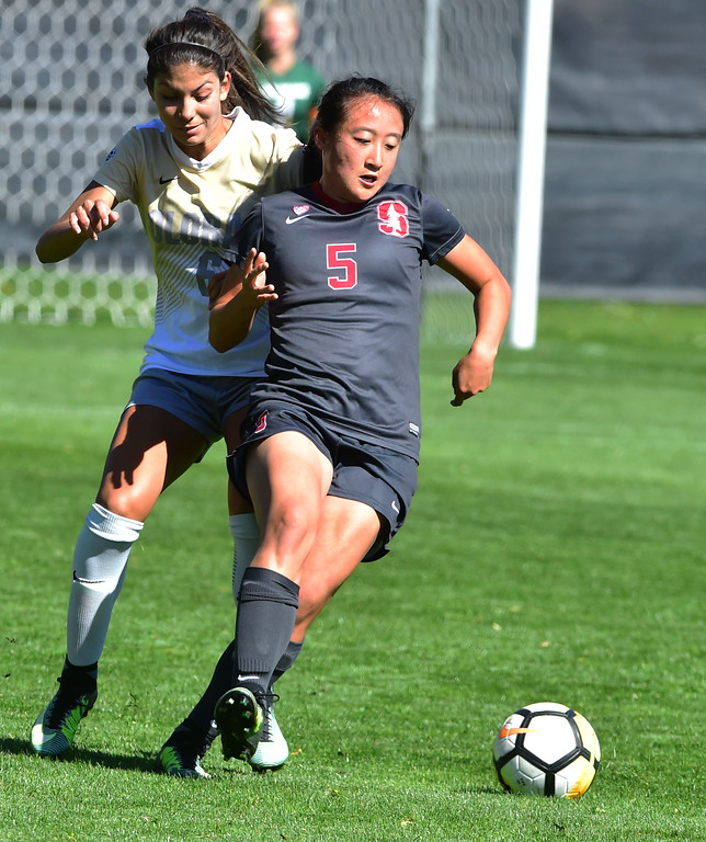 . University of Colorado\'s Hannah Cardenas battles for the ball with Stanford\'s Michelle Xiao during their game at Prentup Field in Boulder on Sunday.  Paul Aiken Staff Photographer Oct 8 2017