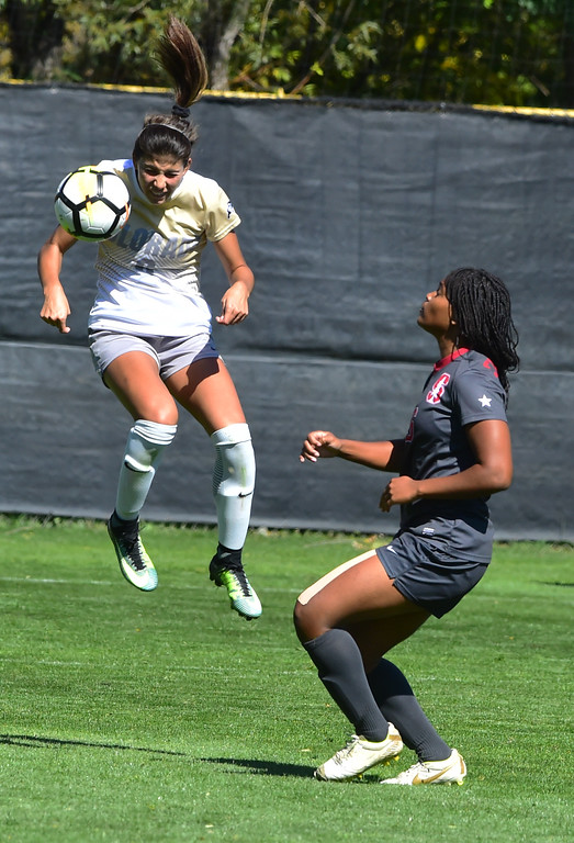 . University of Colorado\'s Hannah Cardenas heads the ball away from Stanford\'s Madison Haley during their game at Prentup Field in Boulder on Sunday.  Paul Aiken Staff Photographer Oct 8 2017