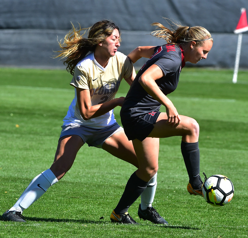 . University of Colorado\'s Joss Orejel defends against  Stanford\'s Kyra Carusa during their game at Prentup Field in Boulder on Sunday.  Paul Aiken Staff Photographer Oct 8 2017