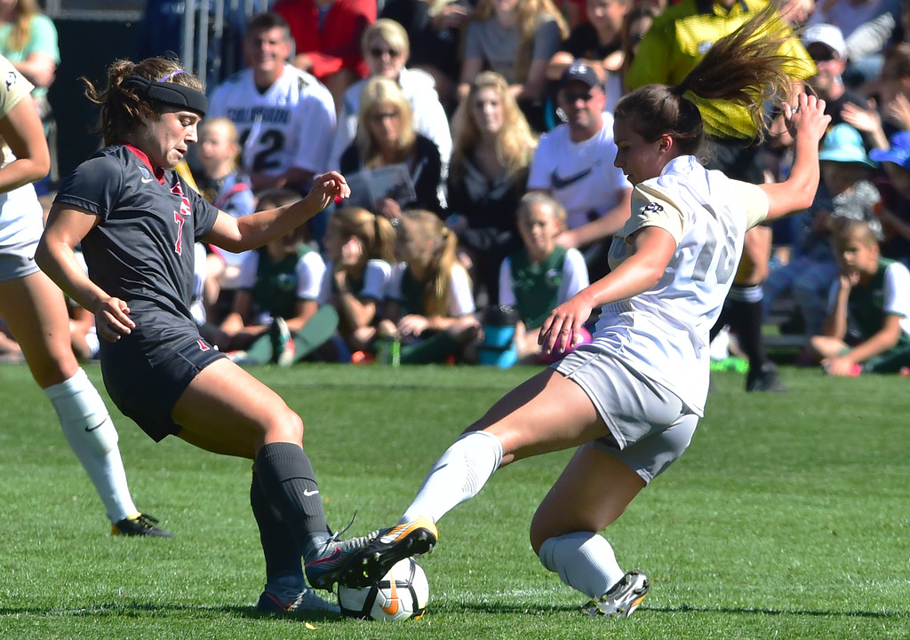 . University of Colorado\'s Erin Greening takes the ball away from Stanford\'s Jays Boissiere during their game at Prentup Field in Boulder on Sunday.  Paul Aiken Staff Photographer Oct 8 2017