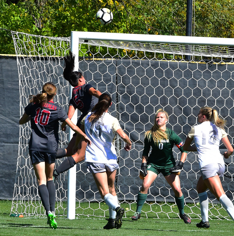. University of Colorado\'s goalie Jalen Tompkins watches  Stanford\'s Michelle Xiao head the ball past the net during their game at Prentup Field in Boulder on Sunday.  Paul Aiken Staff Photographer Oct 8 2017