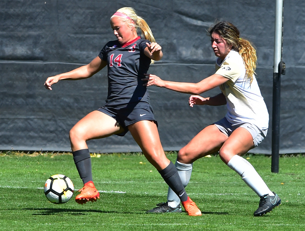 . University of Colorado\'s Joss Orejel defends against Stanford\'s Civana Kuhlmann during their game at Prentup Field in Boulder on Sunday.  Paul Aiken Staff Photographer Oct 8 2017