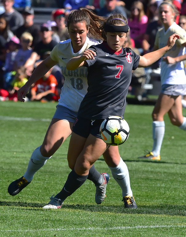 . University of Colorado\'s Cassie Phillips tries to get to the ball through Stanford\'s Jays Boissiere during their game at Prentup Field in Boulder on Sunday.  Paul Aiken Staff Photographer Oct 8 2017