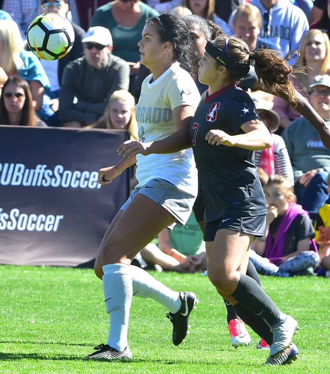 . University of Colorado\'s Megan Massey works the ball against Stanford\'s Jaye Boissiere during their game at Prentup Field in Boulder on Sunday.  Paul Aiken Staff Photographer Oct 8 2017