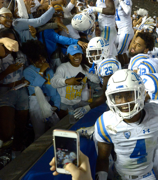 UCLA Bruins celebrate with fans as they defeated the Colorado Buffaloes 27-23 during a NCAA college football game at the Rose Bowl in Pasadena, Calif., Saturday, Sept. 30, 2017. (Photo by Keith Birmingham, Pasadena Star-News/SCNG)