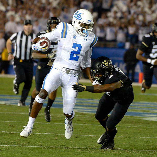 UCLA Bruins wide receiver Jordan Lasley (2) runs for a first down past Colorado Buffaloes defensive back Nick Fisher (7) in the first half of a NCAA college football game at the Rose Bowl in Pasadena, Calif., Saturday, Sept. 30, 2017. (Photo by Keith Birmingham, Pasadena Star-News/SCNG)