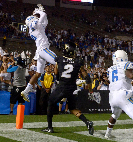 UCLA Bruins defensive back Octavius Spencer (18) intercept a Colorado Buffaloes pass and goes out of bounds to end the game as the UCLA Bruins defeated the Colorado Buffaloes 27-23 during a NCAA college football game at the Rose Bowl in Pasadena, Calif., Saturday, Sept. 30, 2017. (Photo by Keith Birmingham, Pasadena Star-News/SCNG)