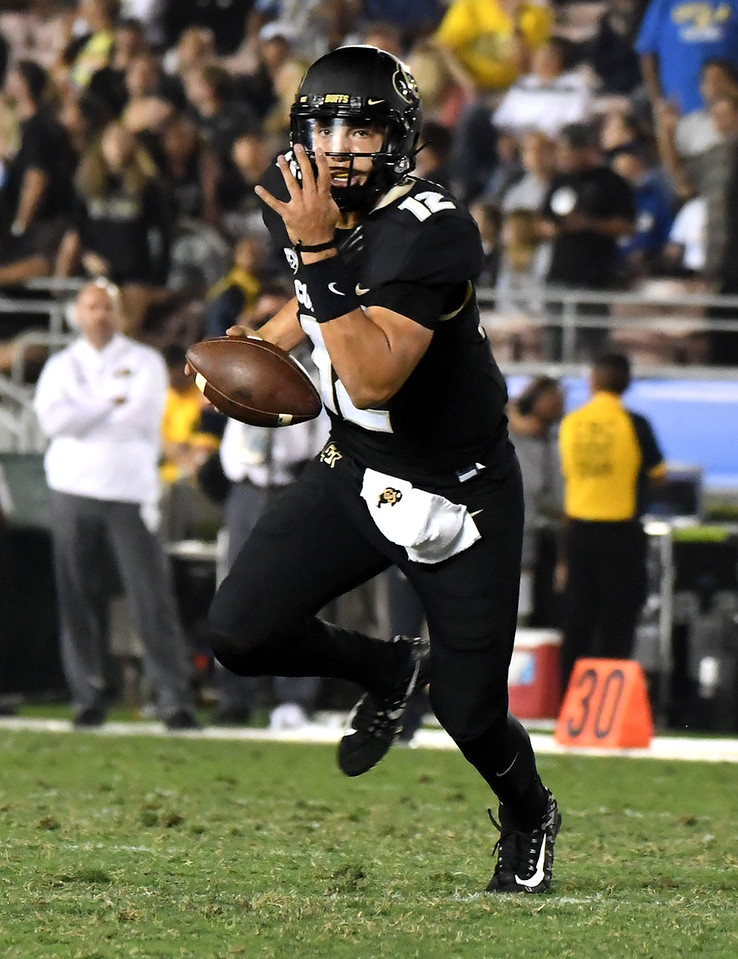 Colorado Buffaloes quarterback Steven Montez (12) scrambles against the UCLA Bruins in the second half of a NCAA college football game at the Rose Bowl in Pasadena, Calif., Saturday, Sept. 30, 2017. UCLA Bruins won 27-23. (Photo by Keith Birmingham, Pasadena Star-News/SCNG)