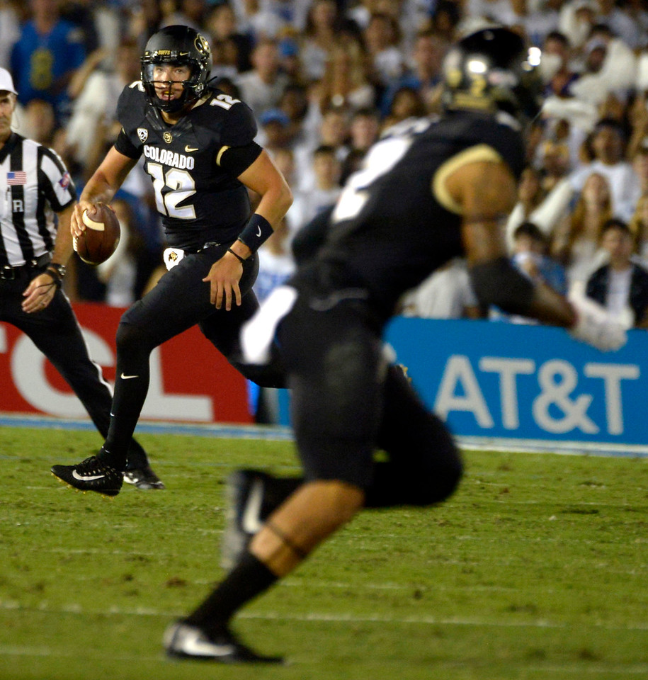 Colorado Buffaloes quarterback Steven Montez (12) scrambles against the UCLA Bruins in the first half of a NCAA college football game at the Rose Bowl in Pasadena, Calif., Saturday, Sept. 30, 2017. (Photo by Keith Birmingham, Pasadena Star-News/SCNG)