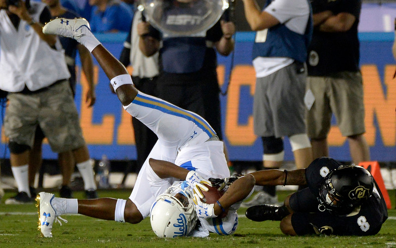 UCLA Bruins wide receiver Jordan Lasley (2) is upended by Colorado Buffaloes defensive back Trey Udoffia (8) after catching a pass for a first down in the first half of a NCAA college football game at the Rose Bowl in Pasadena, Calif., Saturday, Sept. 30, 2017. (Photo by Keith Birmingham, Pasadena Star-News/SCNG)