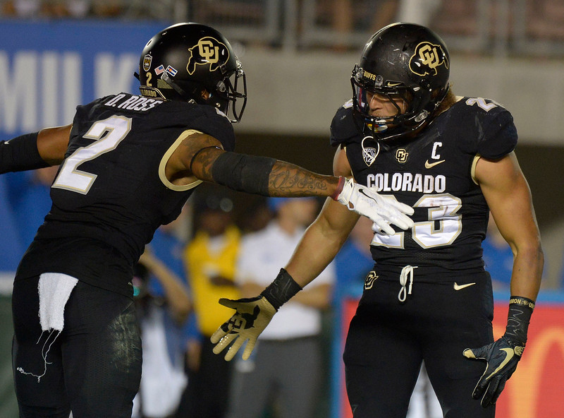 Colorado Buffaloes running back Phillip Lindsay (23) celebrates with teammate wide receiver Devin Ross (2) after running for touchdown against the UCLA Bruins in the first half of a NCAA college football game at the Rose Bowl in Pasadena, Calif., Saturday, Sept. 30, 2017. (Photo by Keith Birmingham, Pasadena Star-News/SCNG)