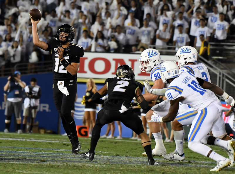 Colorado Buffaloes quarterback Steven Montez (12) passes against the UCLA Bruins in the second half of a NCAA college football game at the Rose Bowl in Pasadena, Calif., Saturday, Sept. 30, 2017. UCLA Bruins won 27-23. (Photo by Keith Birmingham, Pasadena Star-News/SCNG)