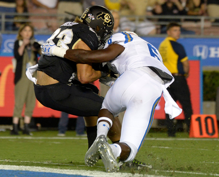 Colorado Buffaloes running back Phillip Lindsay (23) runs for a touchdown past UCLA Bruins linebacker Josh Woods (2) in the first half of a NCAA college football game at the Rose Bowl in Pasadena, Calif., Saturday, Sept. 30, 2017. (Photo by Keith Birmingham, Pasadena Star-News/SCNG)
