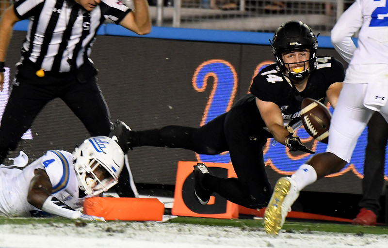 Colorado Buffaloes wide receiver Jay MacIntyre (14) drops a p[ass in the end zone past UCLA Bruins defensive back Jaleel Wadood (4) in the second half of a NCAA college football game at the Rose Bowl in Pasadena, Calif., Saturday, Sept. 30, 2017. UCLA Bruins won 27-23. (Photo by Keith Birmingham, Pasadena Star-News/SCNG)