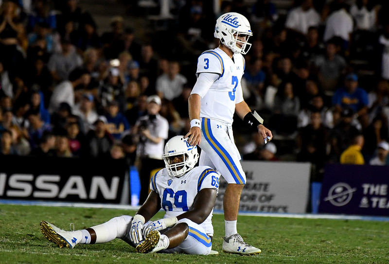 UCLA Bruins quarterback Josh Rosen (3) walks past teammate offensive lineman Najee Toran (69) in the second half of a NCAA college football game against the Colorado Buffaloes at the Rose Bowl in Pasadena, Calif., Saturday, Sept. 30, 2017. UCLA Bruins won 27-23. (Photo by Keith Birmingham, Pasadena Star-News/SCNG)