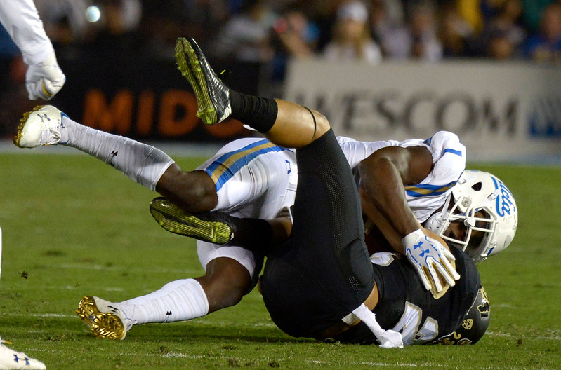 UCLA Bruins defensive back Darnay Holmes (1) tackles Colorado Buffaloes running back Phillip Lindsay (23) in the first half of a NCAA college football game at the Rose Bowl in Pasadena, Calif., Saturday, Sept. 30, 2017. (Photo by Keith Birmingham, Pasadena Star-News/SCNG)