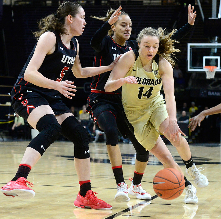 . BOULDER, CO - DECEMBER 30,  2018 University of Colorado\'s Kennedy Leonard drives past  Utah\'s Megan Huff and Daneesha Provo at the CU Events Center on the University of Colorado Boulder Campus on Sunday December 30, 2018. More photos go to buffzone. com  (Photo by Paul Aiken/Staff Photographer)