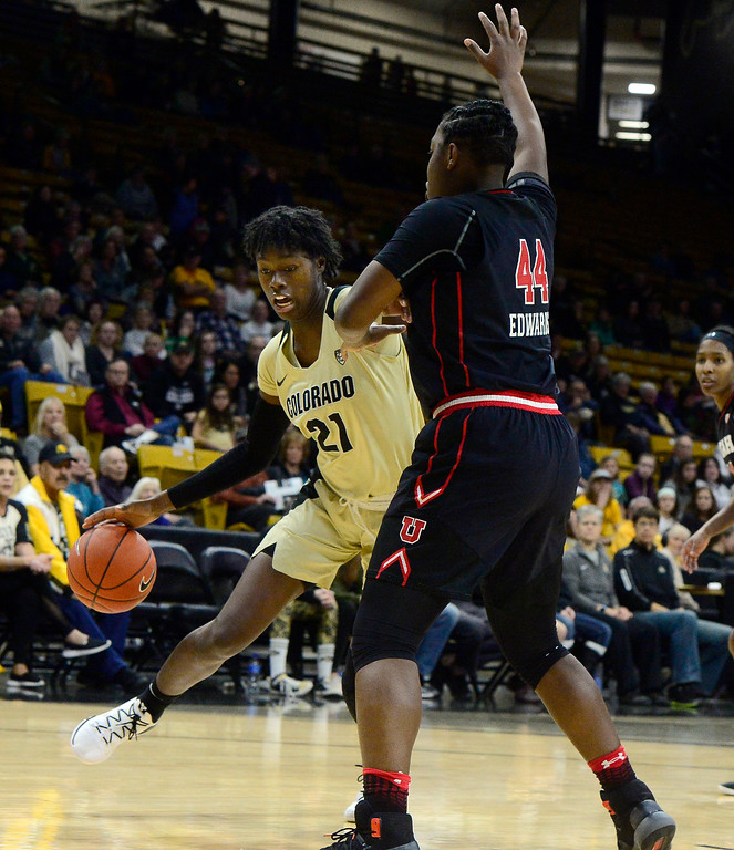 . BOULDER, CO - DECEMBER 30,  2018 University of Colorado\'s Mya Hollingshed drives to the basket past Utah\'s Dre\'Una Edwards at the CU Events Center on the University of Colorado Boulder Campus on Sunday December 30, 2018. More photos go to buffzone. com  (Photo by Paul Aiken/Staff Photographer)