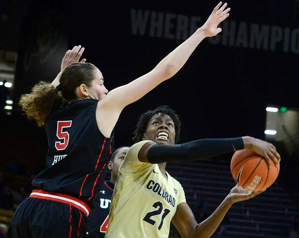 . BOULDER, CO - DECEMBER 30,  2018 University of Colorado\'s Mya Hollingshed drives to the basket past Utah\'s Megan Huff at the CU Events Center on the University of Colorado Boulder Campus on Sunday December 30, 2018. More photos go to buffzone. com  (Photo by Paul Aiken/Staff Photographer)
