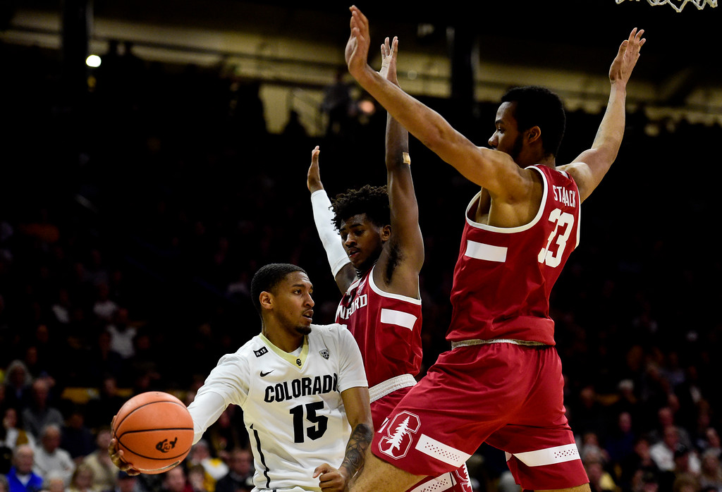 . University of Colorado\'sDominique Collier (No. 15) looks to pass while covered by Stanford Trevor Stanback (No. 33) and Deacon Davis (No. 1) at the Coors Event Center in Boulder, Colorado on Feb. 11, 2018. (Photo by Matthew Jonas/Staff Photographer)