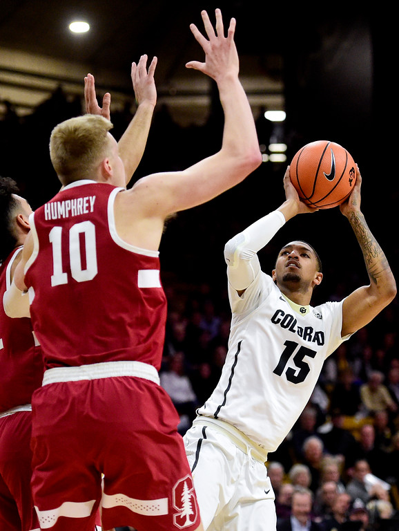 . University of Colorado\'s Dominique Collier (No. 15) shoots past the defense of Stanford\'s (No. 10) and Dorian Pickens (No. 11) at the Coors Event Center in Boulder, Colorado on Feb. 11, 2018. (Photo by Matthew Jonas/Staff Photographer)
