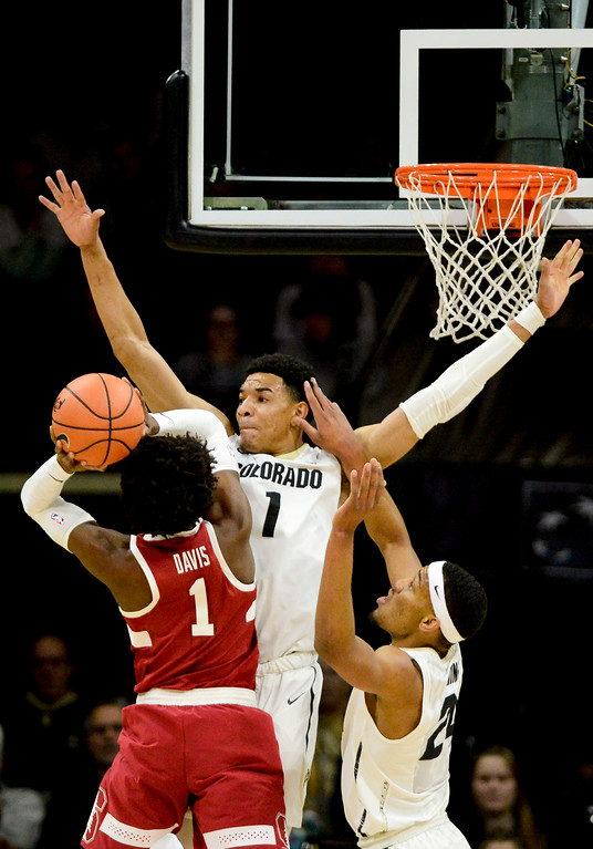 . University of Colorado\'s Tyler Bey (No. 1) and George King (No. 24) cover Stanford\'s Deacon Davis (No. 1) at the Coors Event Center in Boulder, Colorado on Feb. 11, 2018. (Photo by Matthew Jonas/Staff Photographer)