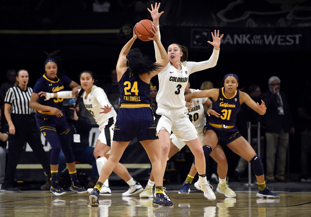 . BOULDER, CO - JANUARY 27, 2019: University of Colorado\'s Emma Clarke plays defense on Recee Caldwell during a NCAA basketball game against the University of California on Sunday at the Coors Event Center on the CU campus in Boulder. More photos: Buffzone.com (Photo by Jeremy Papasso/Staff Photographer)