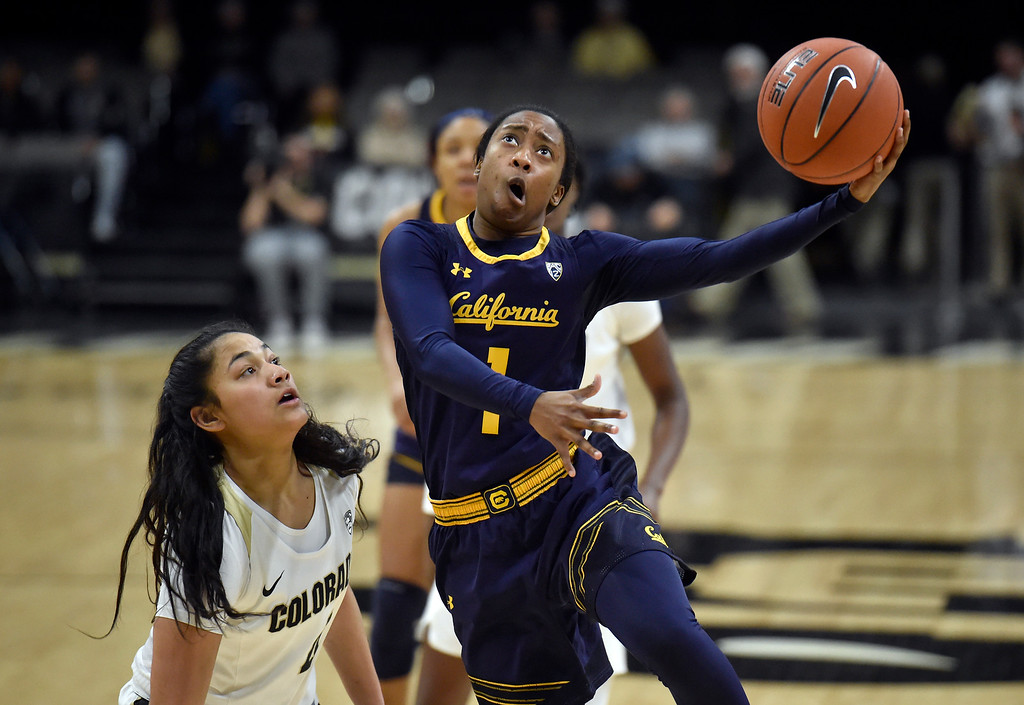 . BOULDER, CO - JANUARY 27, 2019: University of California\'s Asha Thomas goes for a layup over Lesila Finau during a NCAA basketball game against the University of Colorado on Sunday at the Coors Event Center on the CU campus in Boulder. More photos: Buffzone.com (Photo by Jeremy Papasso/Staff Photographer)