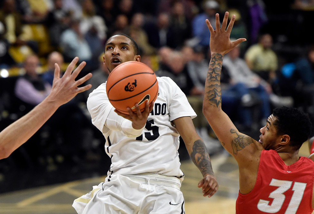 . University of Colorado\'s Dominique Collier drives to the hoop past Troy Simons during a NCAA game against New Mexico on Wednesay at the Coors Event Center in Boulder. More photos: www.Buffzone.com Jeremy Papasso/ Staff Photographer 12/06/2017