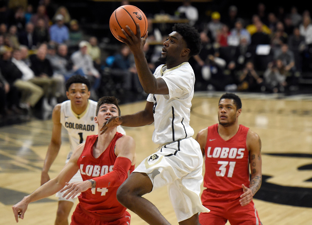 . University of Colorado\'s Namon Wright drives to the hoop during a NCAA game against New Mexico on Wednesay at the Coors Event Center in Boulder. More photos: www.Buffzone.com Jeremy Papasso/ Staff Photographer 12/06/2017