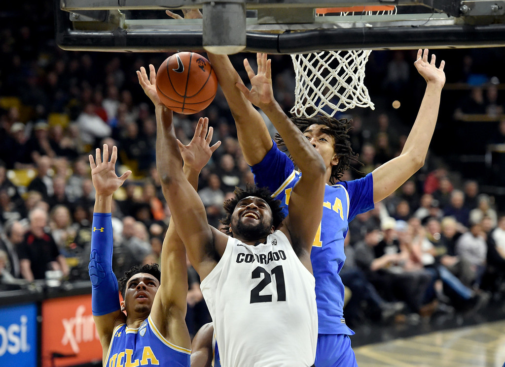 . BOULDER, CO - MARCH 7, 2019: University of Colorado\'s Evan Battey takes a shot under a swarm of defenders during a NCAA game against UCLA on Thursday at the CU Events Center on the CU campus in Boulder. More photos: Buffzone.com  (Photo by Jeremy Papasso/Staff Photographer)