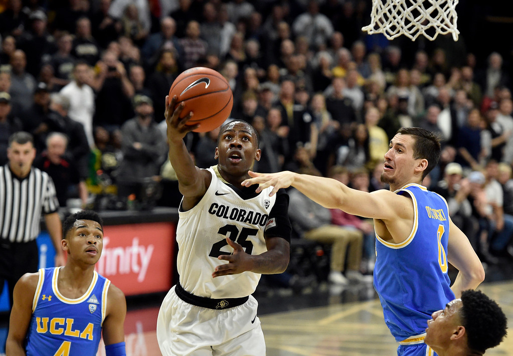 . BOULDER, CO - MARCH 7, 2019: University of Colorado\'s  McKinley Wright IV goes for a layup over Alex Olesinski during a NCAA game against UCLA on Thursday at the CU Events Center on the CU campus in Boulder. More photos: Buffzone.com  (Photo by Jeremy Papasso/Staff Photographer)