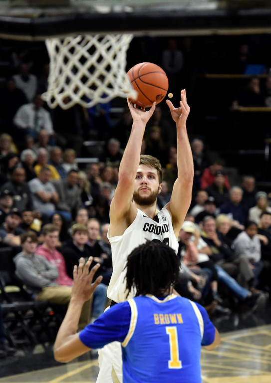 . BOULDER, CO - MARCH 7, 2019: University of Colorado\'s Lucas Siewert sinks a shot over Moses brown during a NCAA game against UCLA on Thursday at the CU Events Center on the CU campus in Boulder. More photos: Buffzone.com  (Photo by Jeremy Papasso/Staff Photographer)