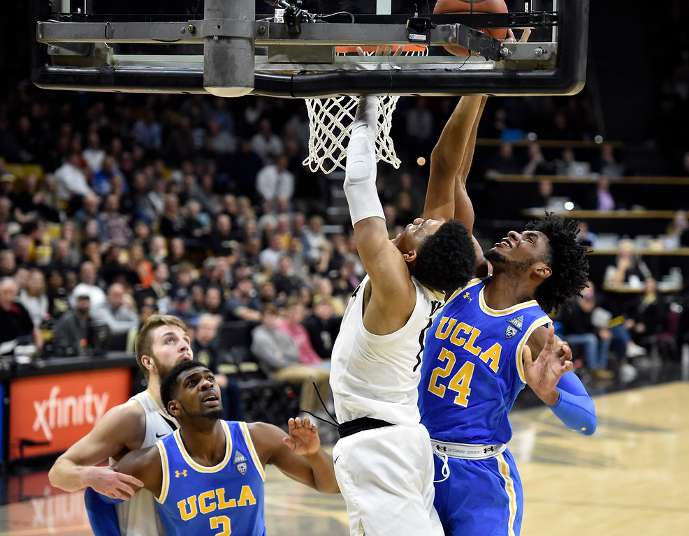 . BOULDER, CO - MARCH 7, 2019: University of Colorado\'s  Tyler Bey gets his shot blocked by Jalen Hill during a NCAA game against UCLA on Thursday at the CU Events Center on the CU campus in Boulder. More photos: Buffzone.com  (Photo by Jeremy Papasso/Staff Photographer)