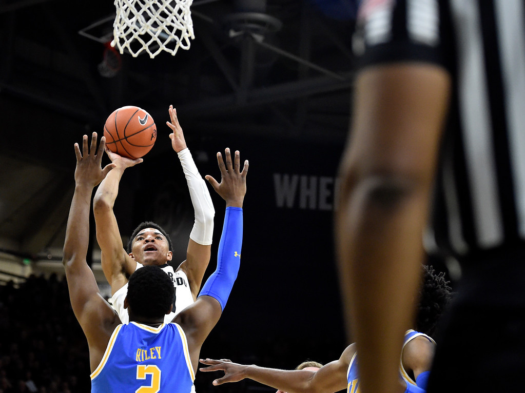 . BOULDER, CO - MARCH 7, 2019: University of Colorado\'s Tyler Bey takes a shot over Cody Riley during a NCAA game against UCLA on Thursday at the CU Events Center on the CU campus in Boulder. More photos: Buffzone.com  (Photo by Jeremy Papasso/Staff Photographer)