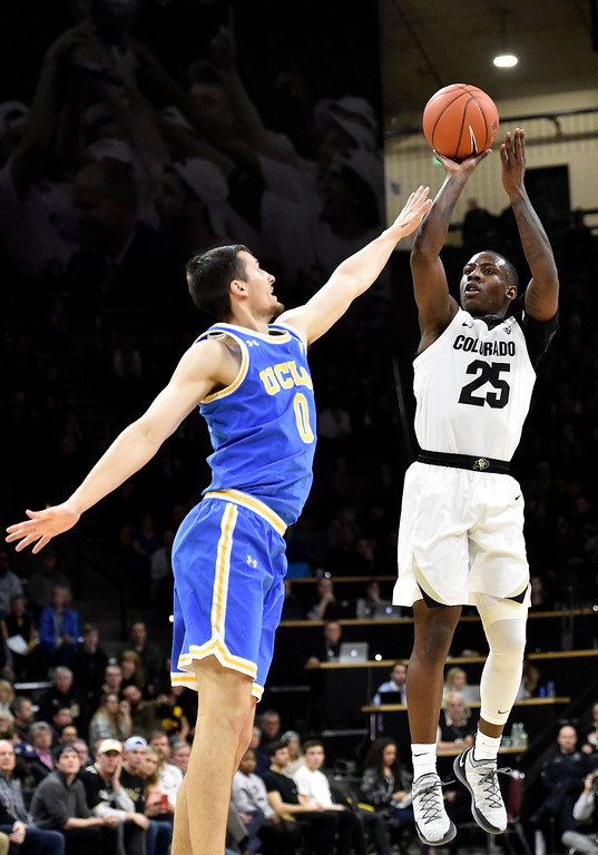 . BOULDER, CO - MARCH 7, 2019: University of Colorado\'s McKinley Wright IV takes a shot over Alex Olesinski during a NCAA game against UCLA on Thursday at the CU Events Center on the CU campus in Boulder. More photos: Buffzone.com  (Photo by Jeremy Papasso/Staff Photographer)