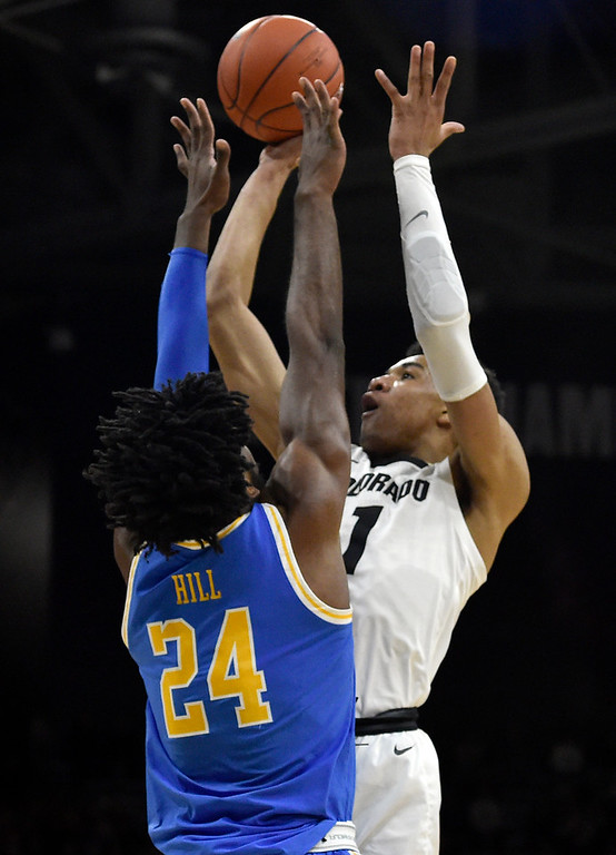 . BOULDER, CO - MARCH 7, 2019: University of Colorado\'s Tyler Bey takes a shot over Jalen Hill during a NCAA game against UCLA on Thursday at the CU Events Center on the CU campus in Boulder. More photos: Buffzone.com  (Photo by Jeremy Papasso/Staff Photographer)