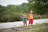 Two boys along rural road