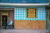 Checkerboard facade and man, evening