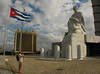 A tourist takes a photo of the Jose Marti statue in Plaza de la Revolucion. The museum tower behind the statue is 358 feet tall, the highest point in Havana, Cuba. (Spud Hilton / The Chronicle)