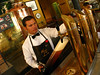 A bartender fills a meter of beer at the Taberna Murallo brewpub in Havana, Cuba.