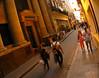 Tourists and shoppers stroll through Habana Vieja (Old Havana) in Havana, Cuba.